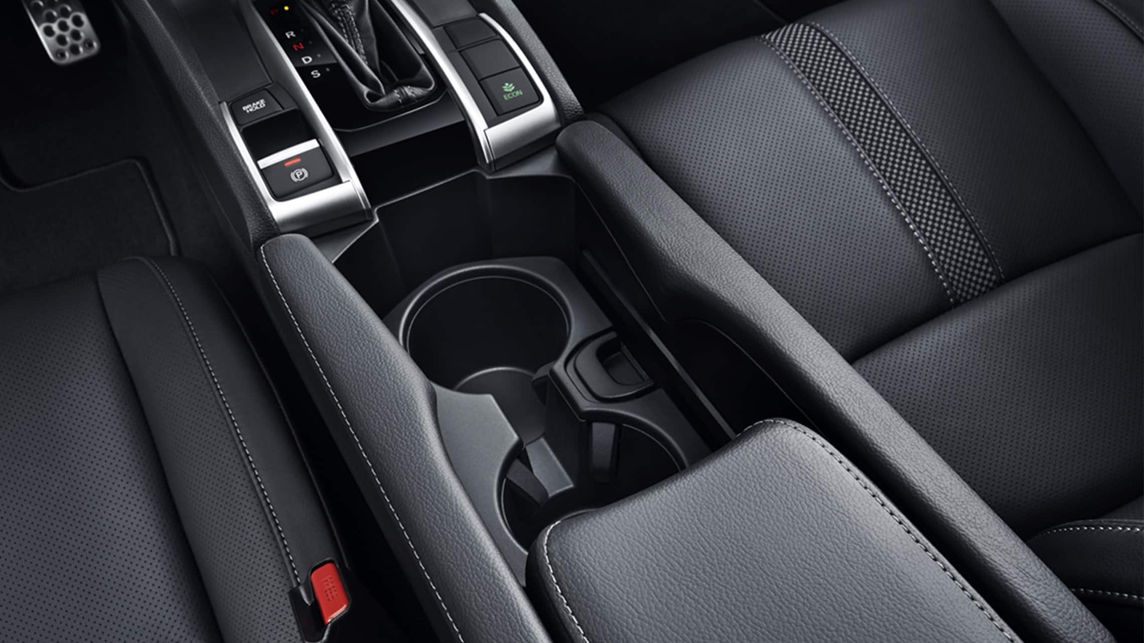 Detail of beverage holders in the 2021 Honda Civic Sport Touring Hatchback.