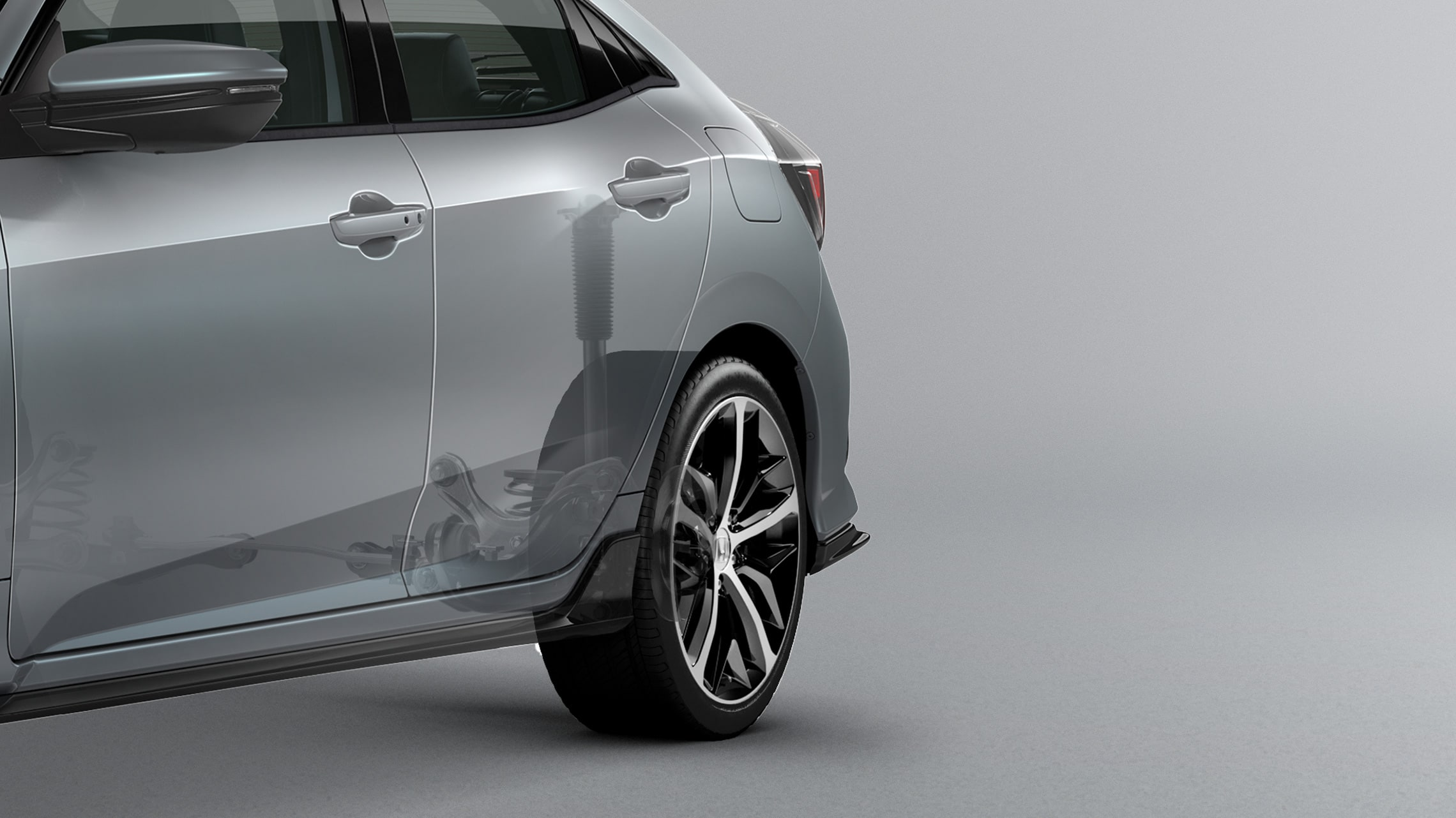 Independent rear suspension cutaway illustration on the 2021 Honda Civic Sport Touring Hatchback in Sonic Gray Pearl.