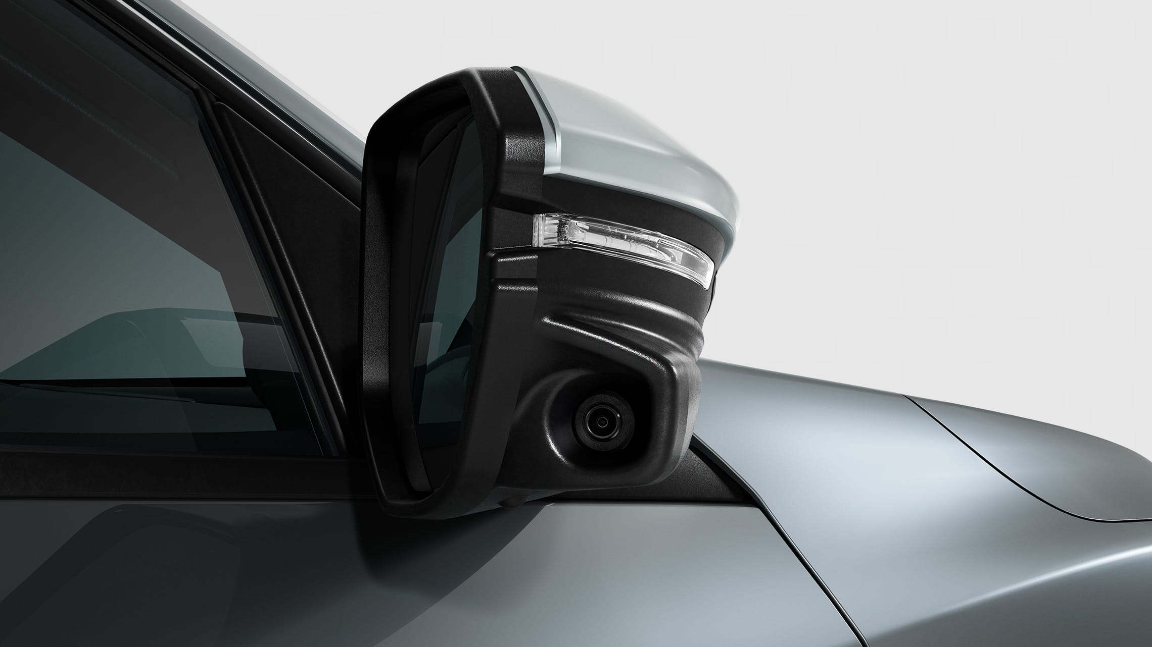 Honda LaneWatch™ camera detail on passenger-side mirror on the 2021 Honda Civic Sport Touring Hatchback in Sonic Gray Pearl.