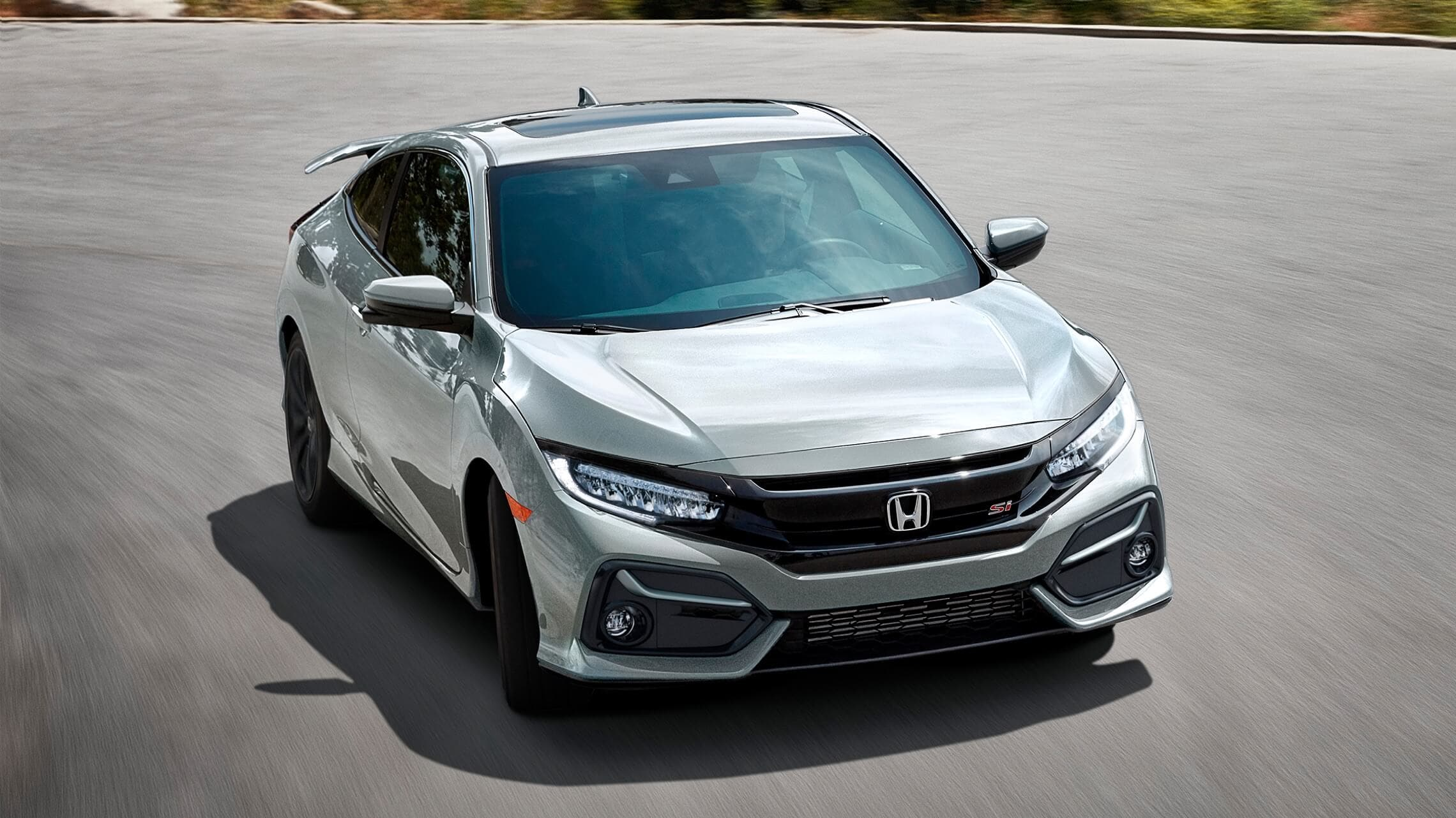 Front 7/8 passenger's side view of 2020 Honda Civic Si Coupe in Lunar Silver Metallic.