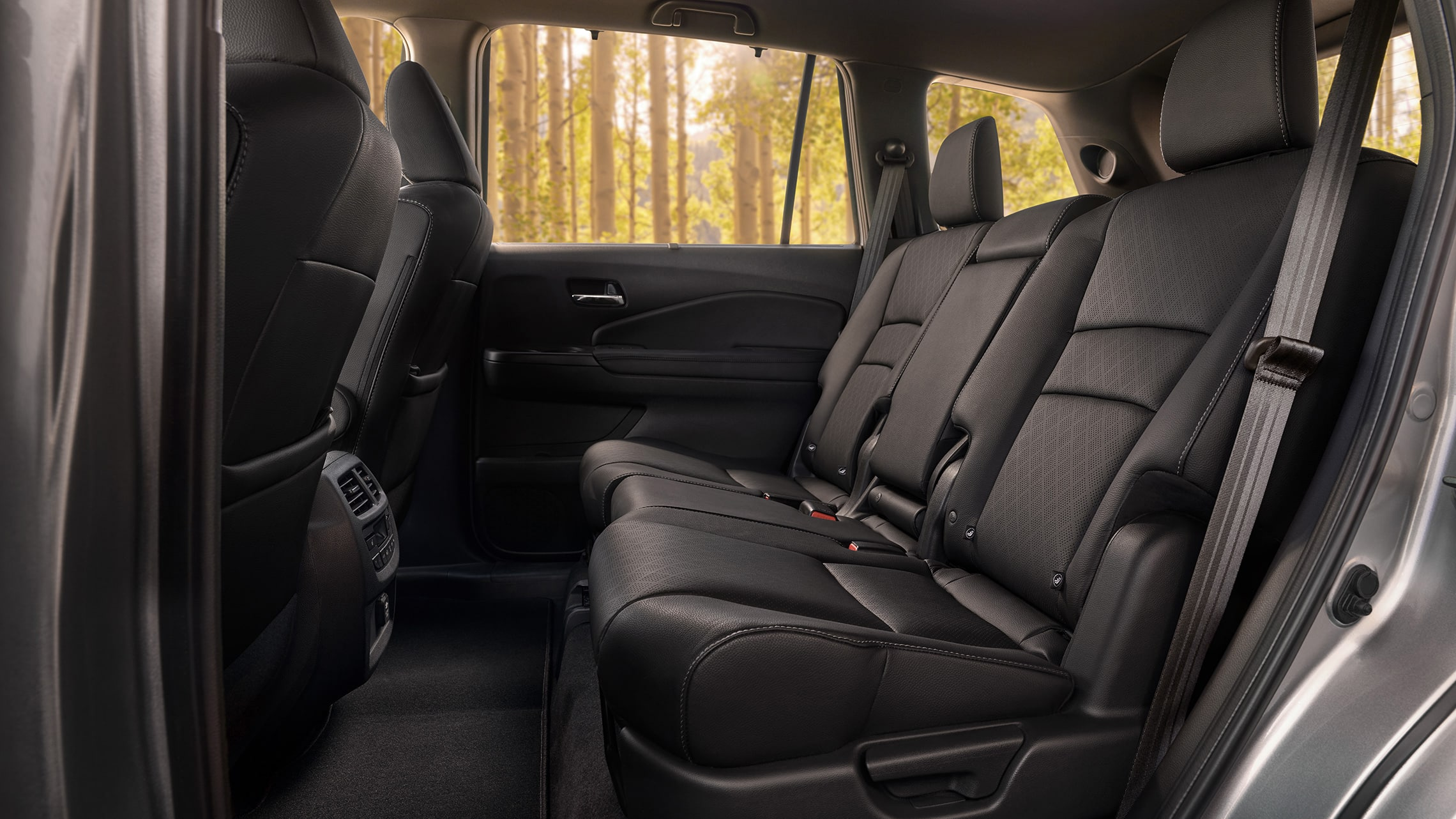 2020 Honda Passport Elite rear interior in Black Leather, displaying spacious 2nd-row seating.