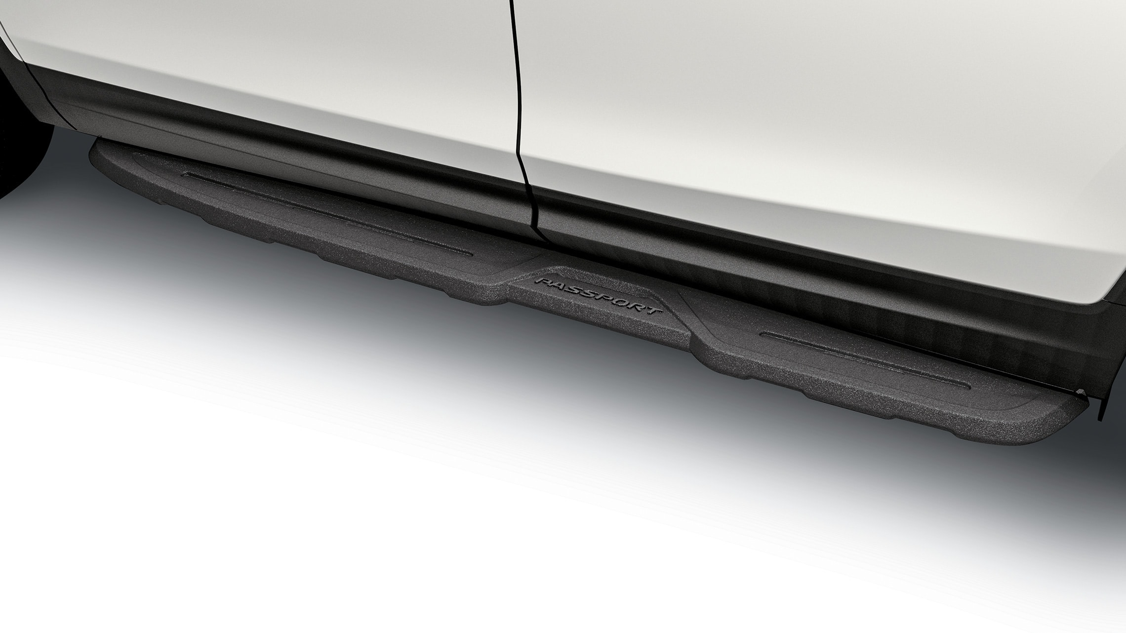 Detail of accessory die-cast running board on the 2021 Honda Passport.