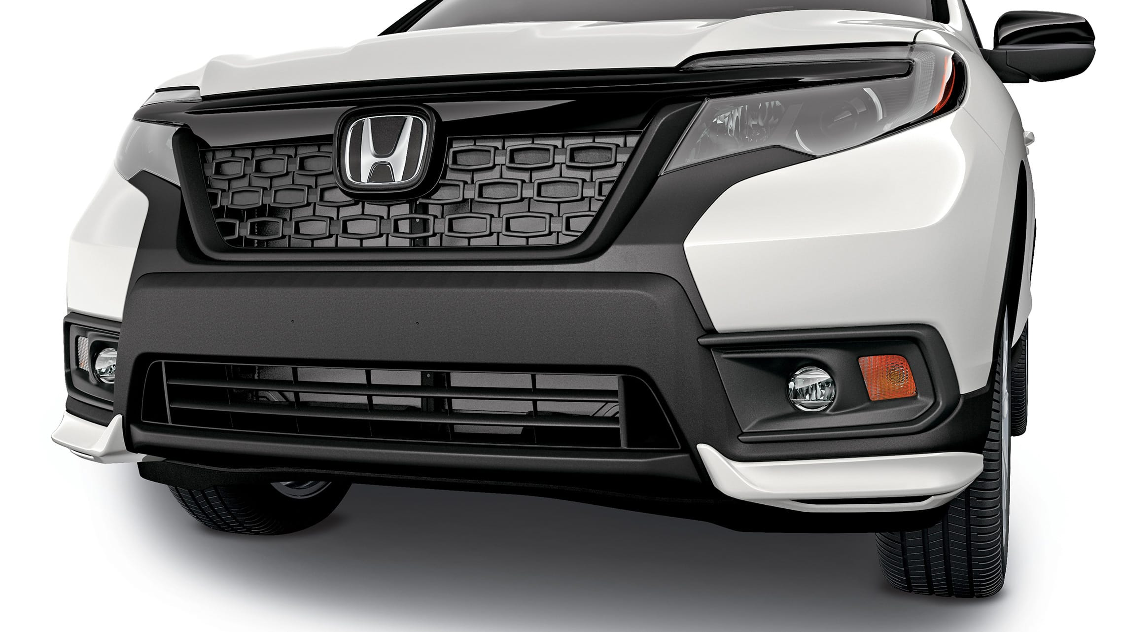 Detail of accessory front underbody spoiler on the 2021 Honda Passport.