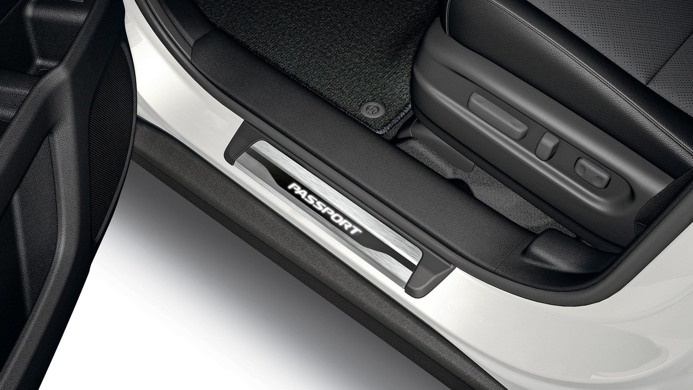 Detail of accessory illuminated door sill trim on the 2021 Honda Passport.