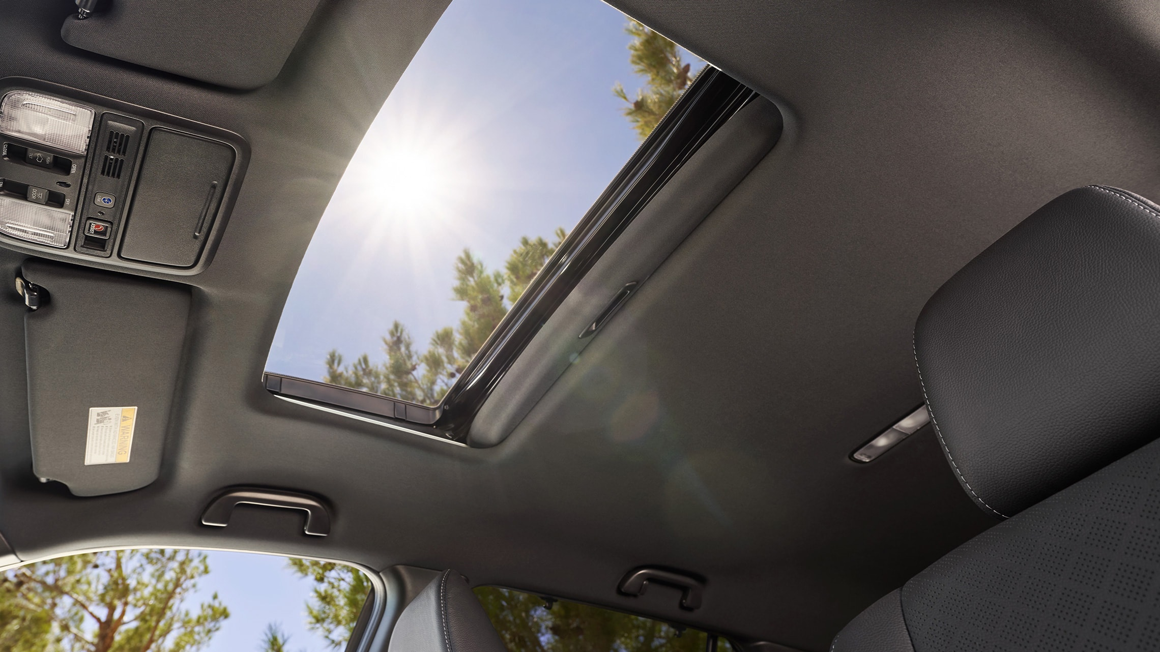 Interior view with one-touch power moonroof detail on the 2021 Honda Passport Elite.