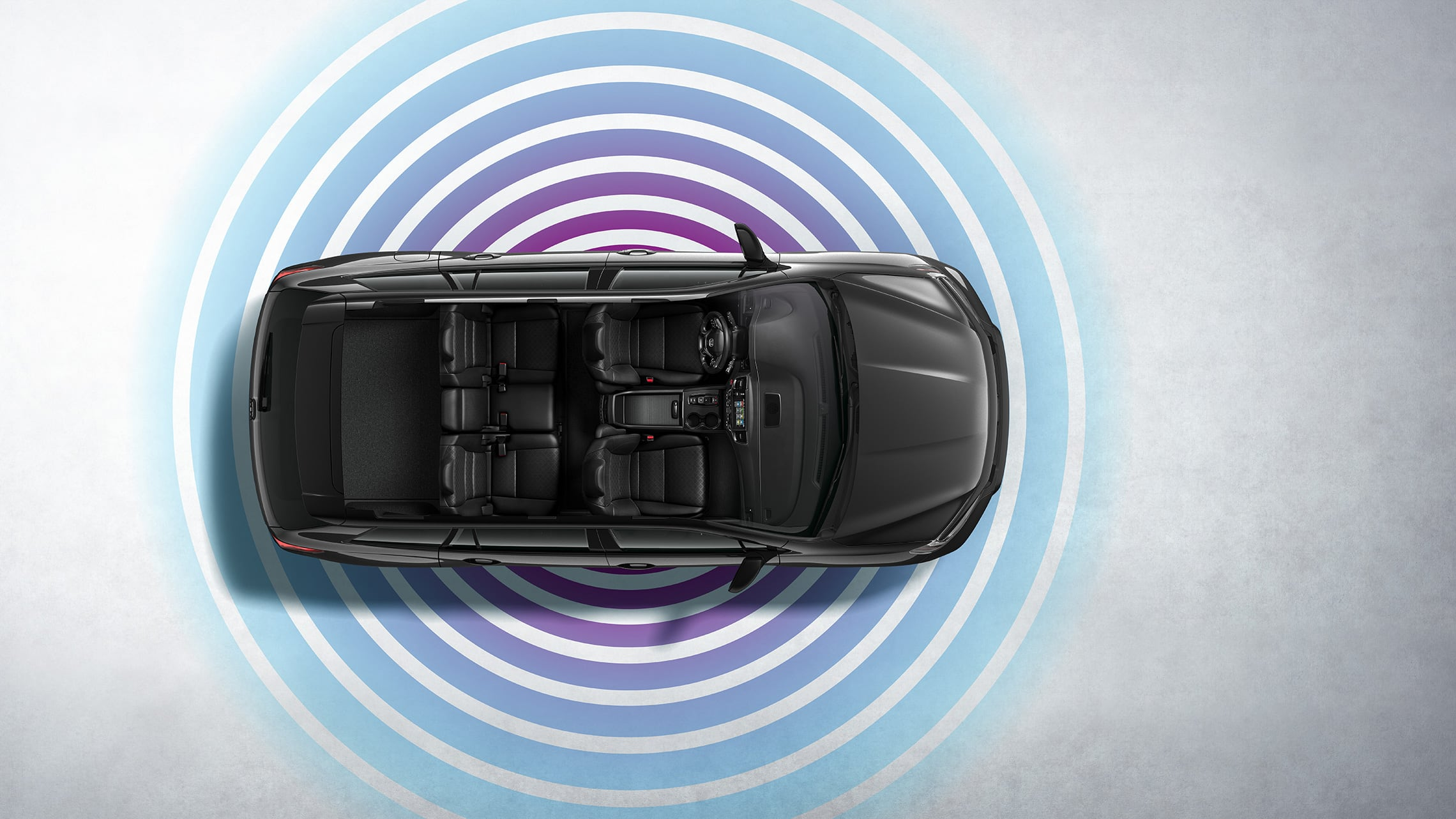 Overhead view of the 2021 Honda Passport Elite in Modern Steel Metallic demonstrating Wi-Fi® hotspot feature.